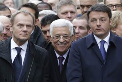 Mahmoud Abbas smirking while at remembrance rally for Charlie Hebdo in Paris after terror slaughter of a dozen writers and cartoonists for the satirical magazine.