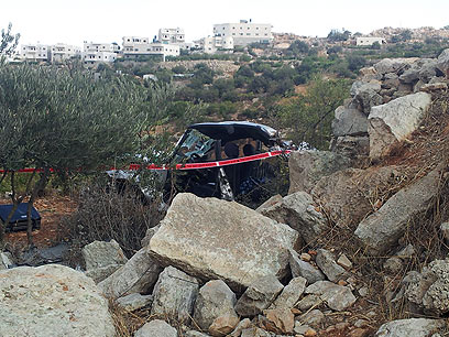 Yonatan & Asher Palmer's Wrecked vehicle after rock attack Arab terrorists