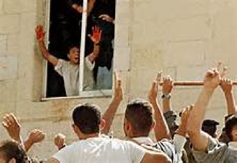 Teenaged Terrorists Displays Bloodied Hands Sending Crowd Gathered to Witness or Take Part in Sacrificing IDF Reservists Tearing Them Apart with Their Bare Hands